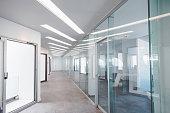 istock Empty corridor in modern office building 1297027202