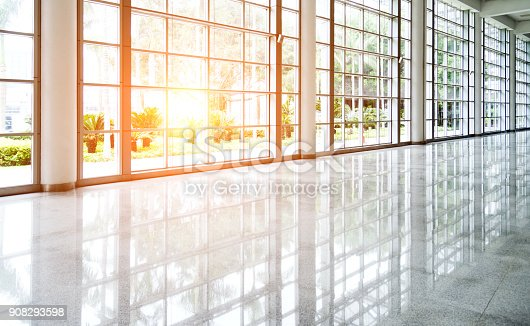 istock Empty corridor  in modern office building 908293598