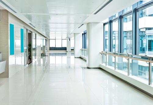 Empty corridor with glass window.