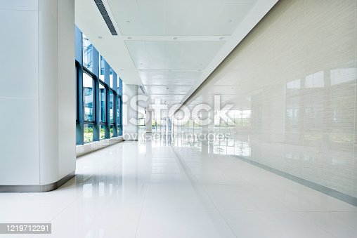 Empty corridor with glass window in office building.