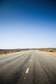 Remote outback road connecting Northern Territory and Western Australia