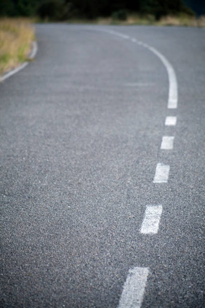empty country road, road sign, white single line. - dotted line stock photos and pictures