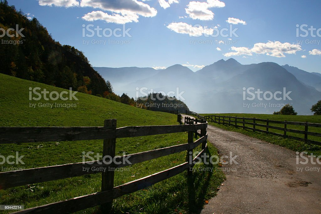 Empty country road winding through the Alps royalty-free stock photo
