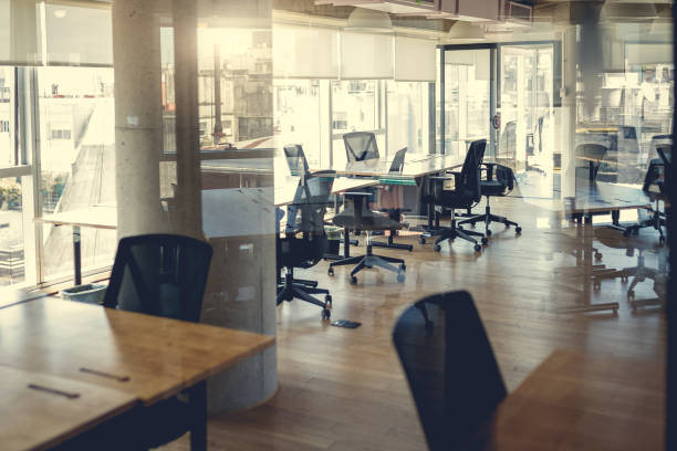 Empty coworking work stations Empty coworking stations empty desk stock pictures, royalty-free photos & images
