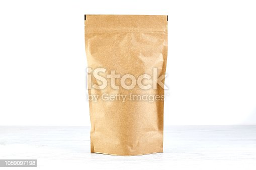 empty craft paper coffee package on white background