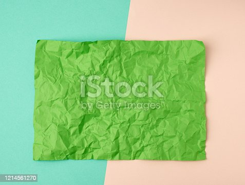 istock empty crumpled green rectangular sheet of paper a4 on a color background 1214561270