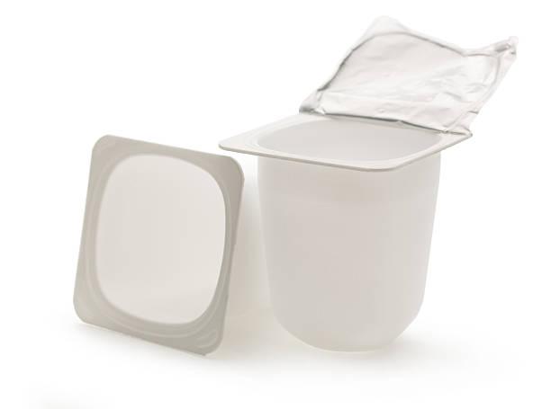 Empty crushed plastic yogurt pots stock photo
