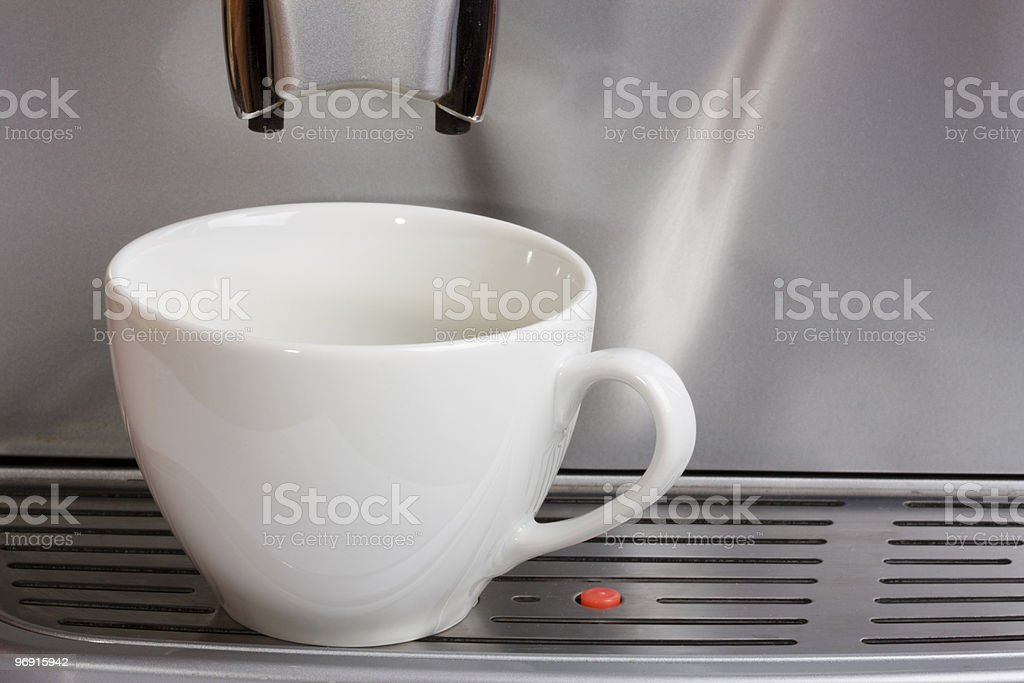Empty cup in espresso coffee machine royalty-free stock photo