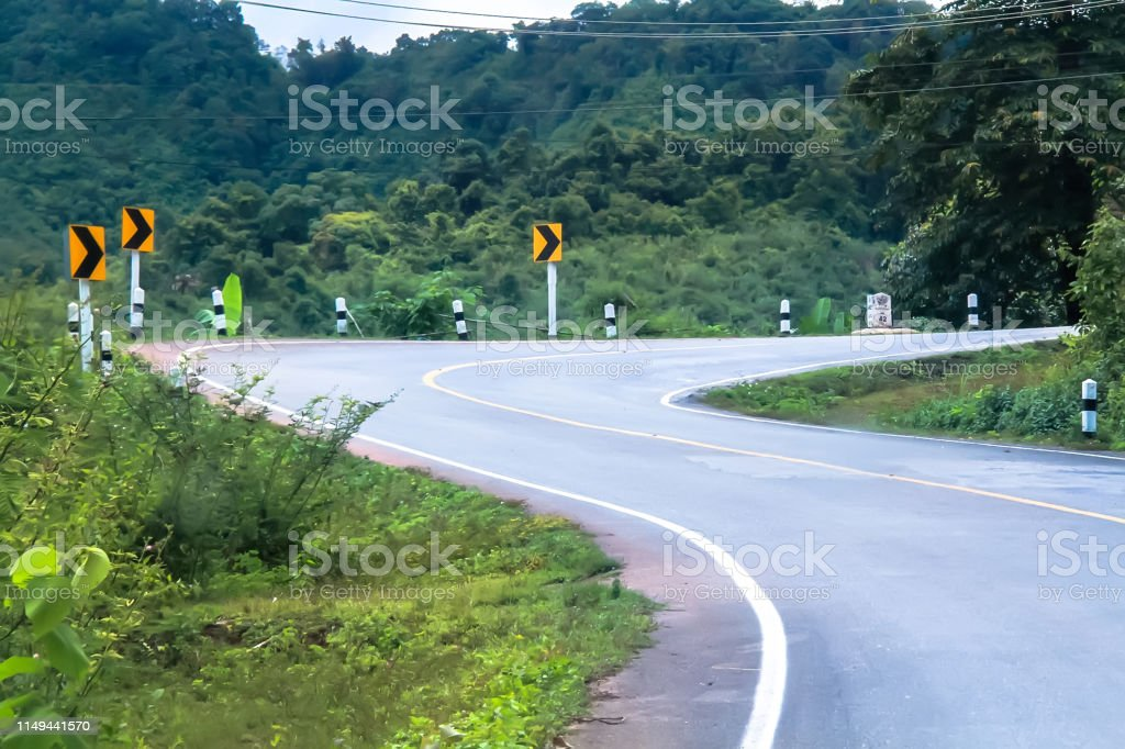 Empty curve road in the mountain and forest, country road in north of...