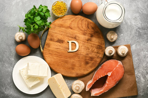 empty cutting board and frame of varied food rich in vitamin d. healthy eating concept. top view, flat lay. - vitamin d zdjęcia i obrazy z banku zdjęć