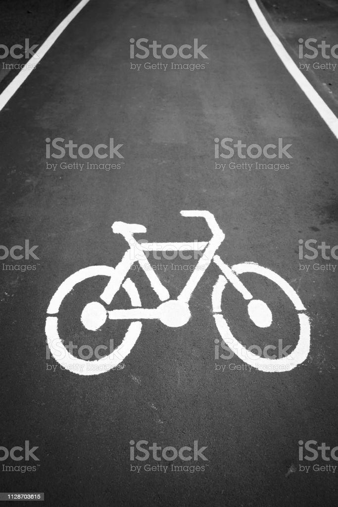 Empty cycle track with bike lane sign stock photo