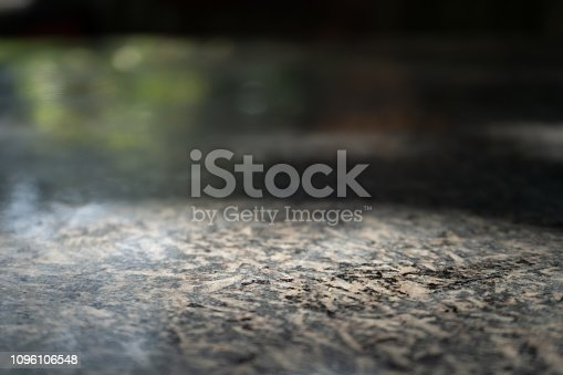 892043040istockphoto Empty dark marble table 1096106548