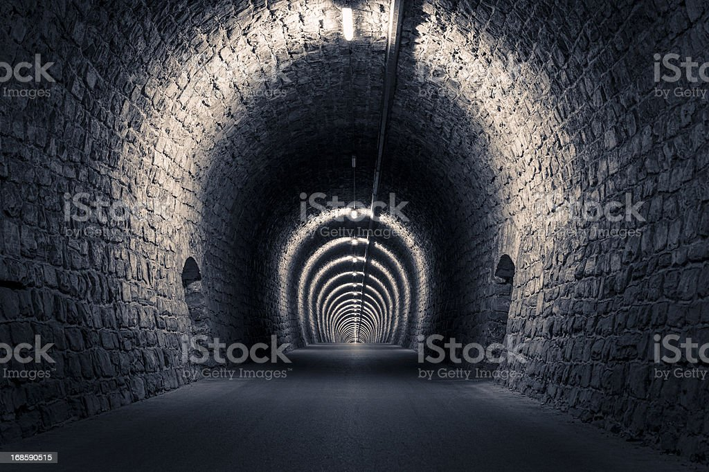 Empty dark tunnel stock photo
