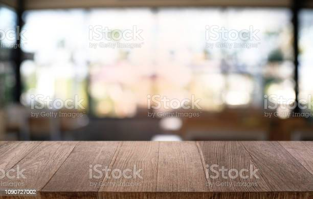 Empty dark wooden table in front of abstract blurred bokeh background picture id1090727002?b=1&k=6&m=1090727002&s=612x612&h=yfdrogkzywcgsxj5p nu0qquy  wgpydb9ud j0g8jo=