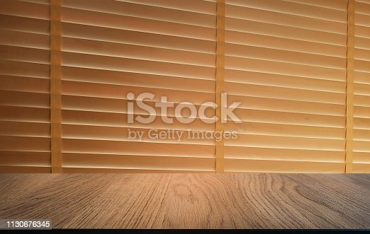 1077234988istockphoto Empty dark wooden table in front of abstract blurred bokeh background of restaurant . can be used for display or montage your products.Mock up for space. 1130676345