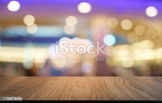 924418708 istock photo Empty dark wooden table in front of abstract blurred bokeh background of restaurant . can be used for display or montage your products.Mock up for space. 1130676453