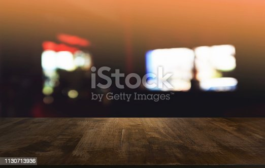 1077234988istockphoto Empty dark wooden table in front of abstract blurred bokeh background of restaurant . can be used for display or montage your products.Mock up for space. 1130713936