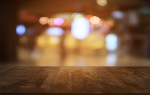 593305530 istock photo Empty dark wooden table in front of abstract blurred bokeh background of restaurant . can be used for display or montage your products.Mock up for space. 1130713949