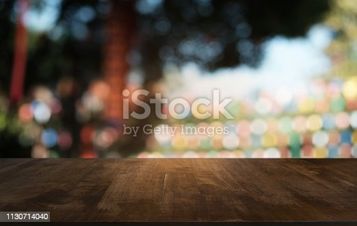 1077234988istockphoto Empty dark wooden table in front of abstract blurred bokeh background of restaurant . can be used for display or montage your products.Mock up for space. 1130714040