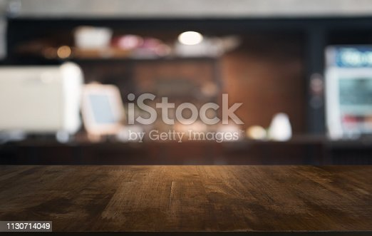 istock Empty dark wooden table in front of abstract blurred bokeh background of restaurant . can be used for display or montage your products.Mock up for space. 1130714049