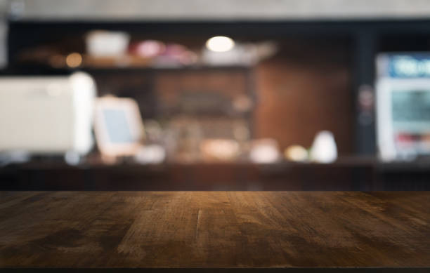 Empty dark wooden table in front of abstract blurred bokeh background of restaurant . can be used for display or montage your products.Mock up for space. stock photo