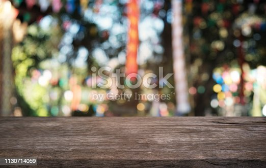 1077234988istockphoto Empty dark wooden table in front of abstract blurred bokeh background of restaurant . can be used for display or montage your products.Mock up for space. 1130714059