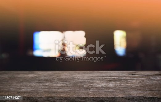 1077234988istockphoto Empty dark wooden table in front of abstract blurred bokeh background of restaurant . can be used for display or montage your products.Mock up for space. 1130714071