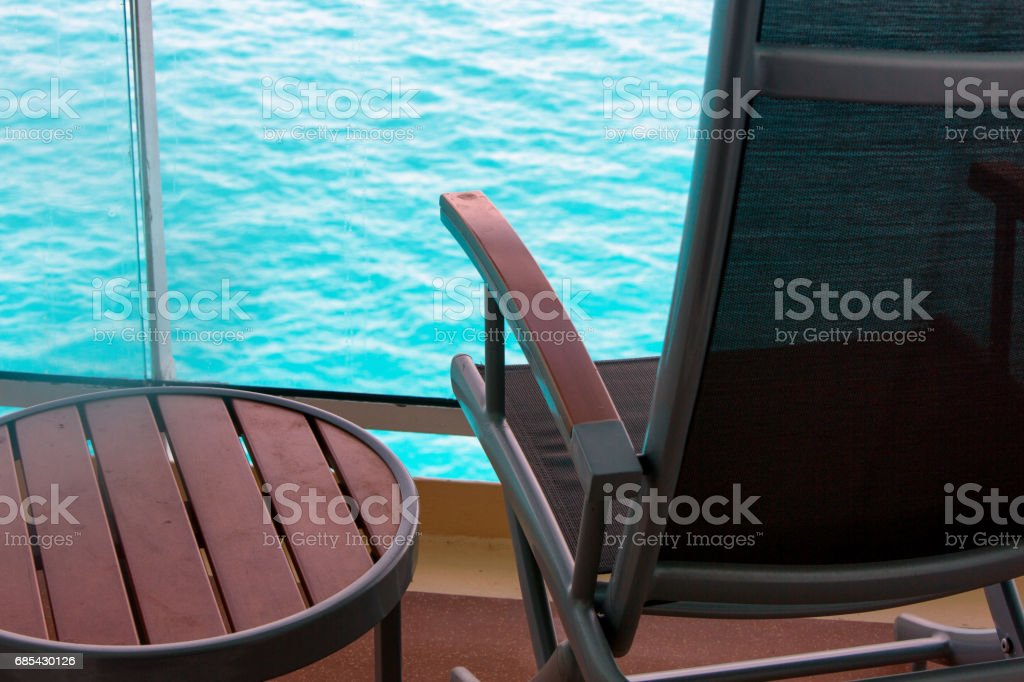 Empty Deck Chair on a Cruise Ship Balcony at Dusk foto de stock royalty-free