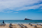 empty deck chairs by sea in spain