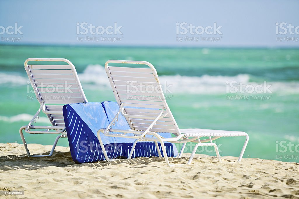 Empty Deck Chairs on a beach royalty-free stock photo