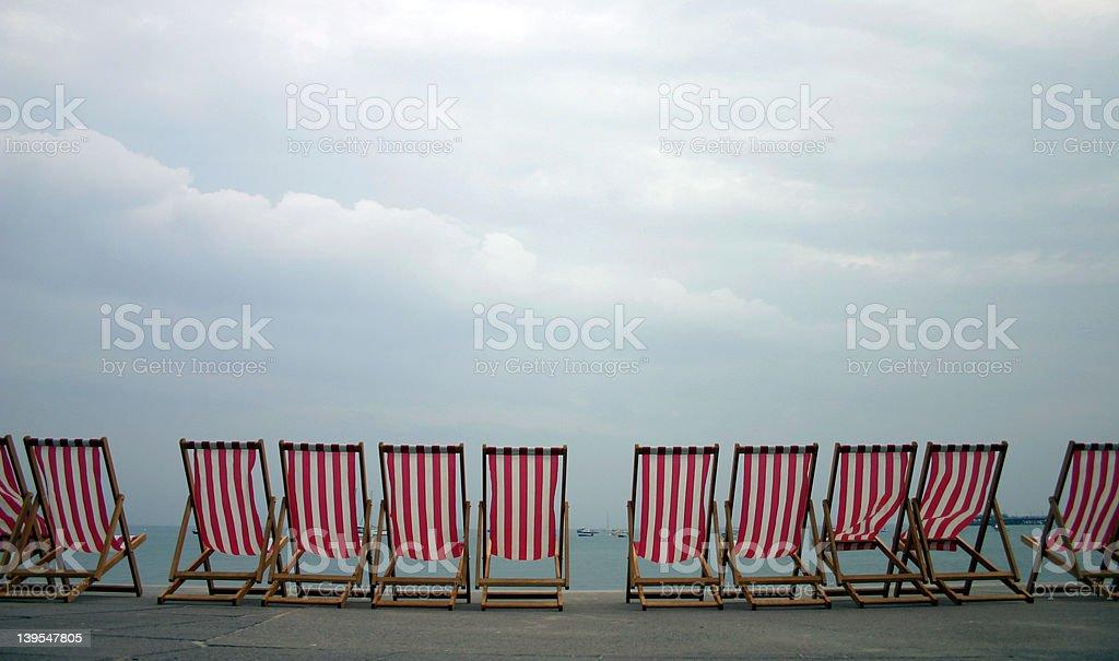empty deck chairs stock photo