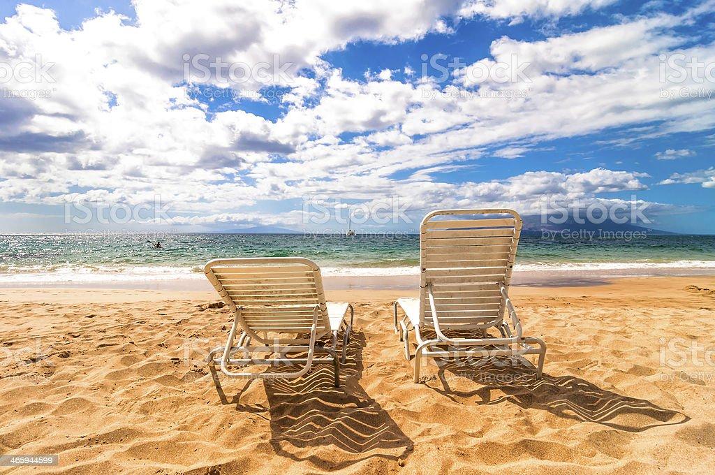 empty deckchairs on Makena Beach in Maui, Hawaii royalty-free stock photo