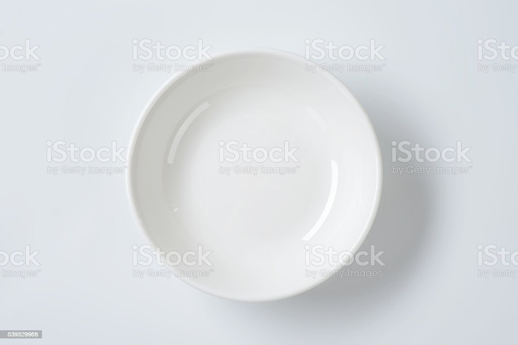 empty deep white plate stock photo