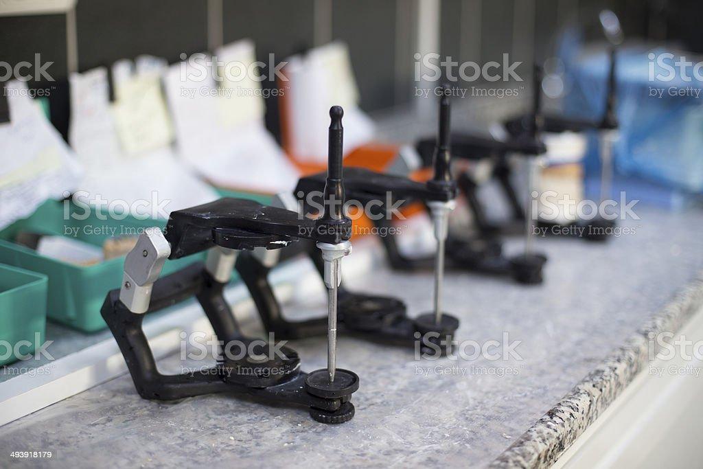 Empty dental lab articulators stock photo
