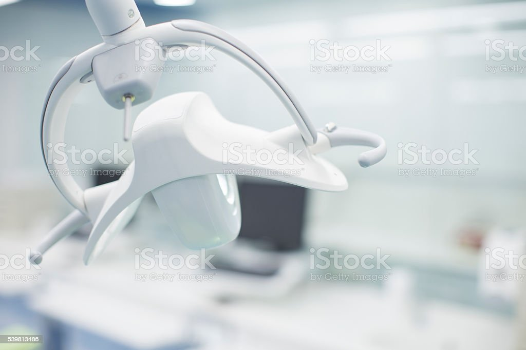 Empty dentist clinic close up on operating lamp stock photo