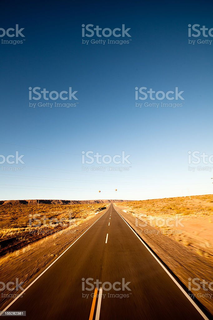 Empty desert road stretching into the distance royalty-free stock photo