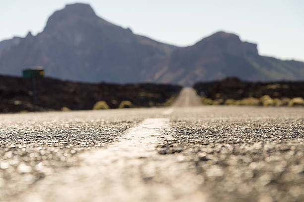 empty desert road with mountains on background - selective focus stock photos and pictures