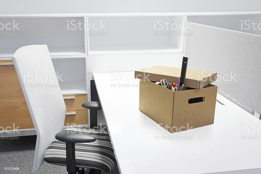 Empty desk after termination of employment. stock photo