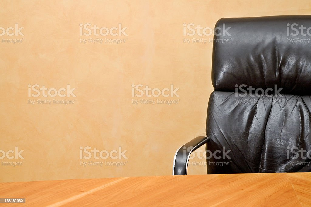 Empty desk and executive chair with copyspace royalty-free stock photo