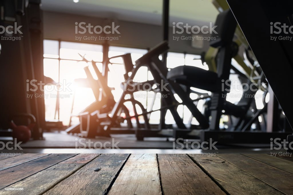 Empty desk space platform and fitness gym background with weight...