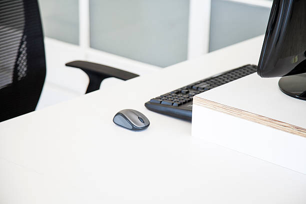 Empty desk with mouse, keyboard and computer Mouse, keyboard and computer on empty desk empty desk stock pictures, royalty-free photos & images