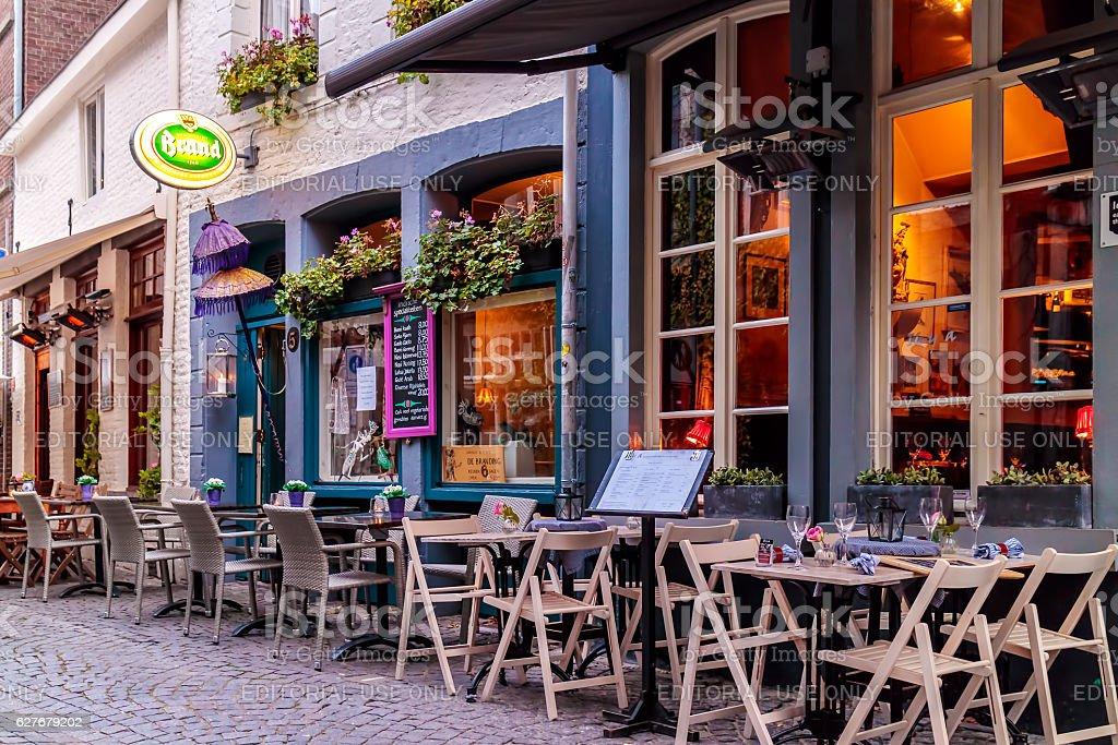 Empty dinner tables in front of restaurants in Maastricht stock photo