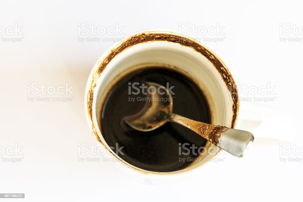 Empty dirty coffee cup on white table background. royalty-free stock photo