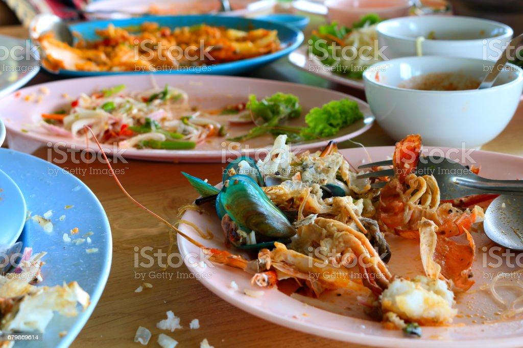 empty dish after food meal party stock photo