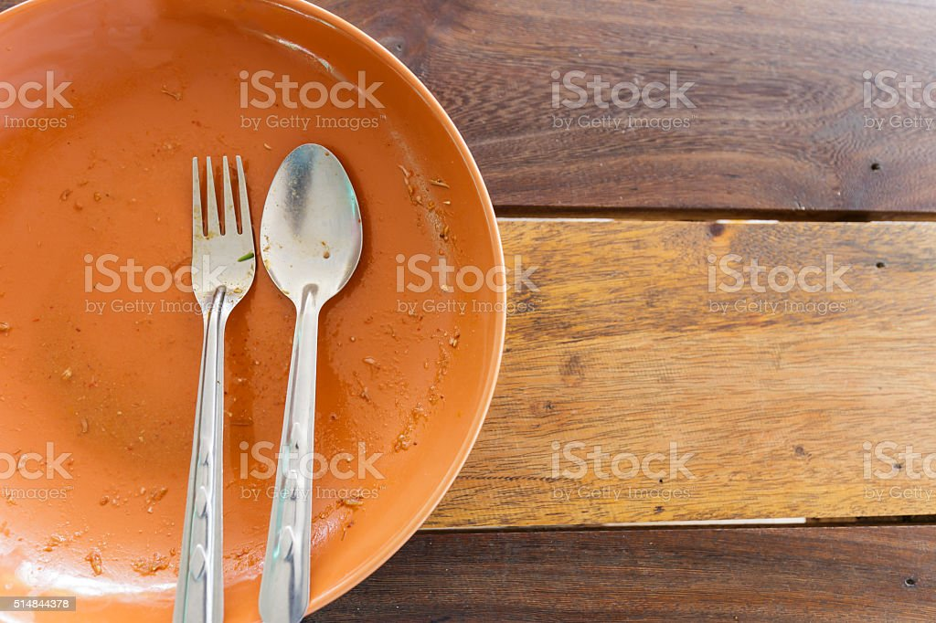 Empty dish after food on wooden table stock photo