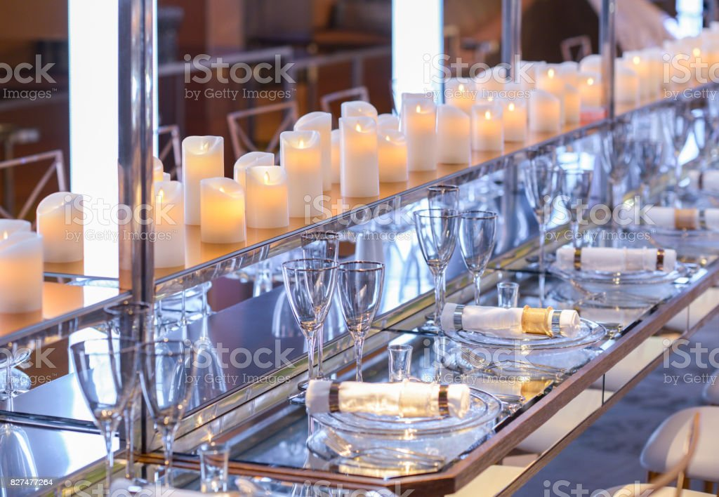 empty dishware  on a long table stock photo