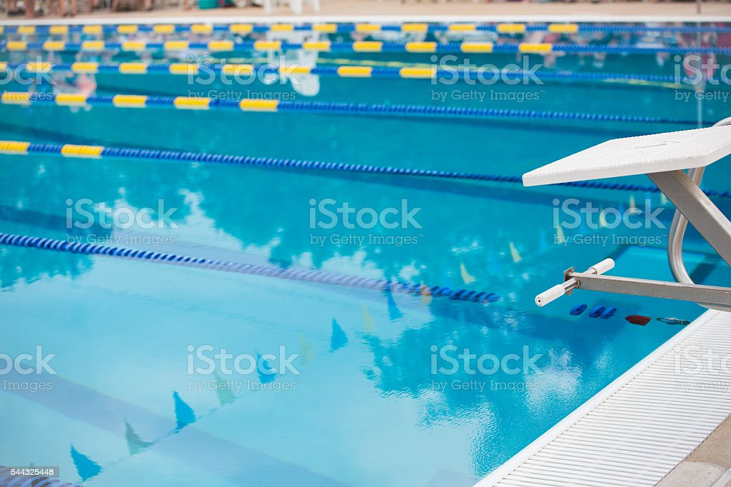 Empty diving block with race lanes in pool stock photo
