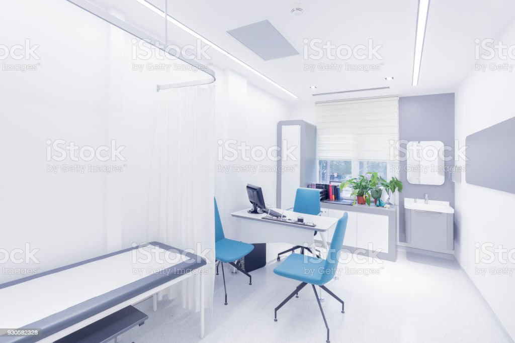 Empty doctor's examination room stock photo