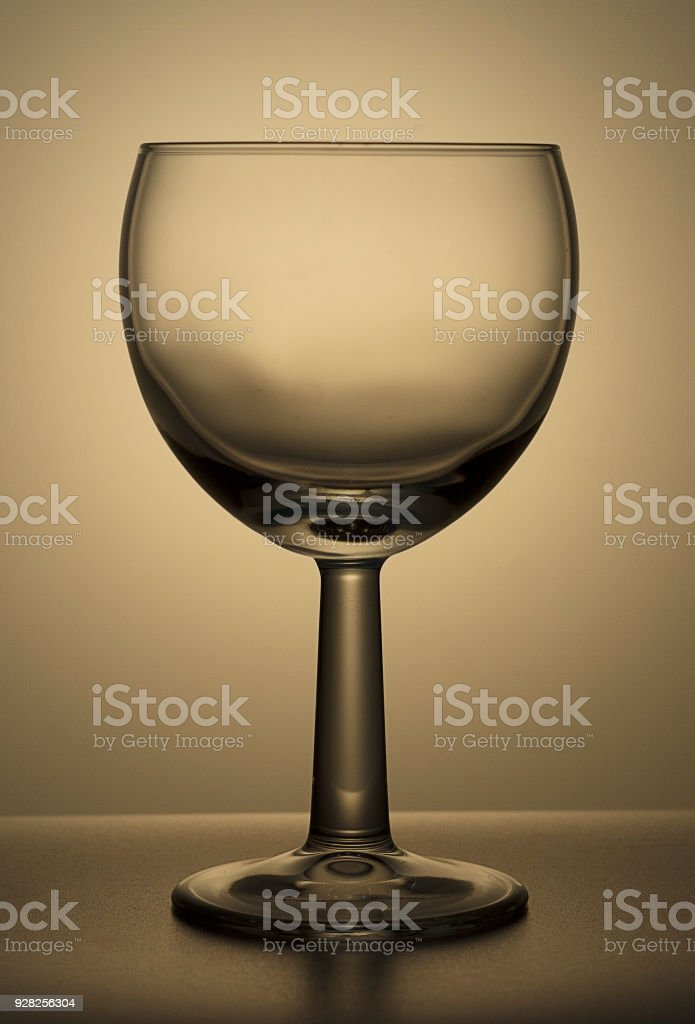 Drinking glass is empty , on a glass board, reflections, colorful...
