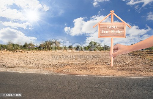 istock Empty dry cracked swamp reclamation soil, land plot for housing construction project with car tire print in rural area and beautiful blue sky with fresh air Land for sales landscape concept 1209903165